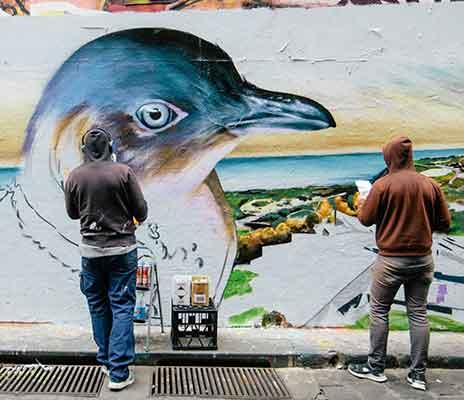 Graffiti Artists painting At Hosier Lane Melbourne